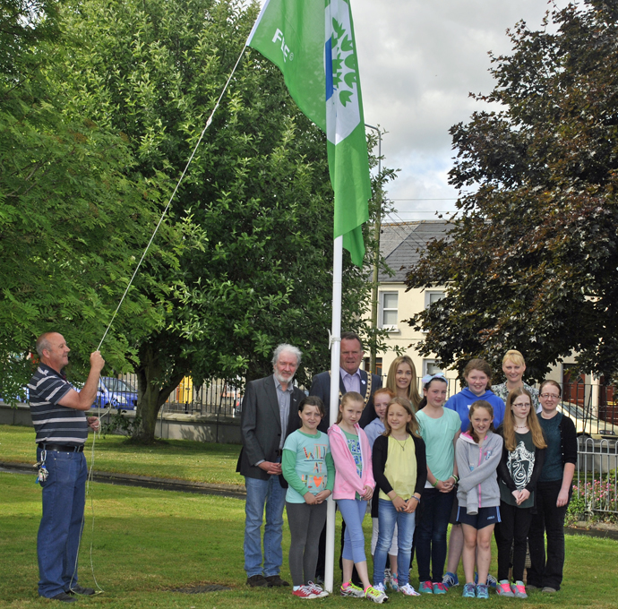 john hoists the flag with our Green Schools Committee and our guests.