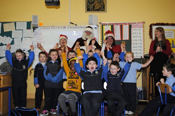 Boys and girls from room 17 and 5 are happy to see Santa