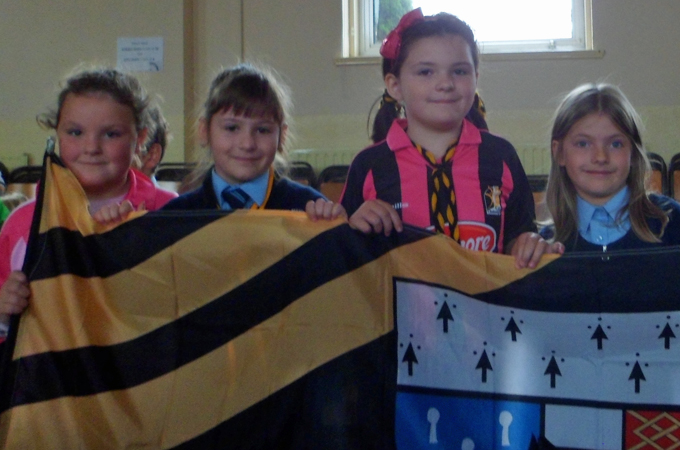 Proudly holding the black and amber flag