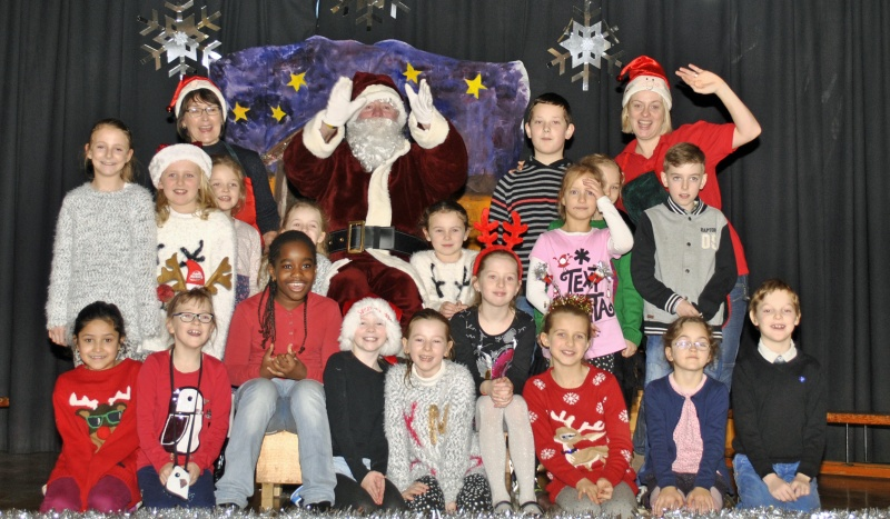 Some boys and girls from 2nd, 3rd and Sn L.U with Santa and Helpers