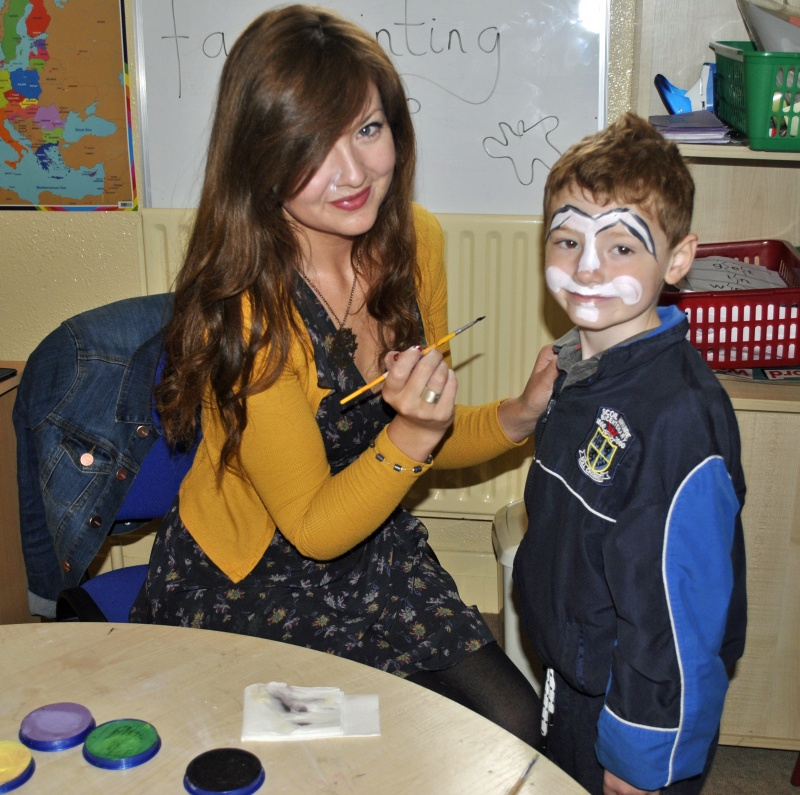 Face painting with Miss Murphy. I could be Spiderman, a Bunny Rabbit or a flower.