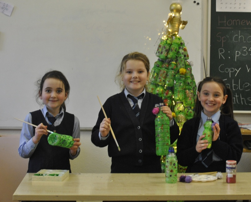 Room 13 girls are putting the finishing touches to their tree.