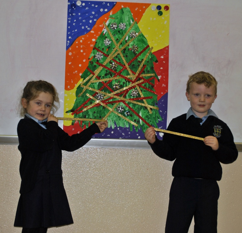 Room 9 are putting the finishing touches to tree